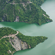 Roads scratch along the hillsides above the Tehri Lake, a manmade and controversial lake created by the Tehri Dam.