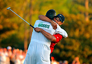 (04/10/05) -- Augusta, GA -- MASTERS --   Tiger Woods celebrates his Masters victory with his caddie Steve Williams after sinking the winning put in a playoff hole on No. 18 during Sunday's final round of The Masters at Augusta National Golf Club.