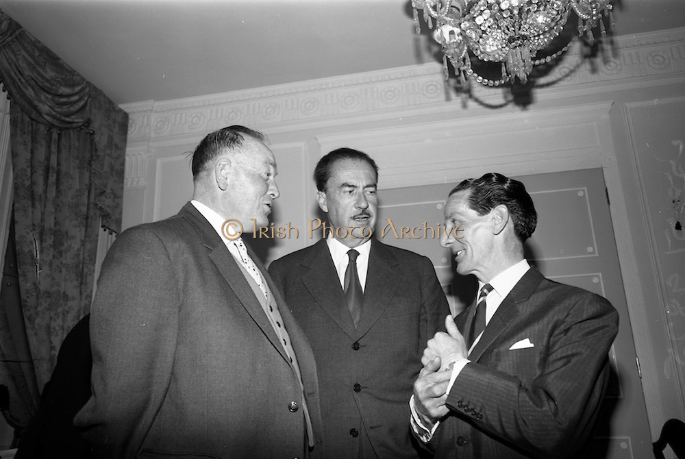 05/05/1965<br /> 05/05/1965<br /> 05 May 1965<br /> Hennessy Press reception at the Gresham Hotel, Dublin to announce the company's plans for sports sponsorship that year. Pictured at the event were (l-r) Mr. A.T. O'Keeffe, Manager, Hennessy (Ireland);   Mr. Patrick Hennessy, Director, Jos. Hennessy and Co. and Mr. Phil Canty, jockey.