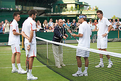 LONDON, ENGLAND - Thursday, June 24, 2010: Colin Fleming (GBR) & Kenneth Skupski (GBR) toss a coin with Arnaud Clement (FRA) & Nicolas Mahut (FRA) before the Gentlemen's Doubles 1st Round match on day four of the Wimbledon Lawn Tennis Championships at the All England Lawn Tennis and Croquet Club. (Pic by David Rawcliffe/Propaganda)