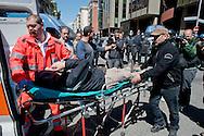 Roma 16 Aprile 2014<br /> Sgomberato palazzo in  via Baldassarre Castiglione alla Montagnola occupato nei giorni scorsi  dai movimenti per il diritto all'abitare da circa  200 persone, la polizia a caricato i manifestanti che protestano per lo sgombero, otto persone sono state ferite. Un manifestante ferito viene portato via in ambulanza<br /> Rome April 16, 2014 <br /> Vacated the building in Via Baldassarre Castiglione,Montagnola district, busy in recent days by the movements for housing rights, by about 200 people, the police charged the demonstrators protesting the eviction, eight people were injured. An injured protester is taken away in ambulance