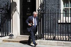 London, UK. 23 July, 2019. Geoffrey Cox QC MP, Attorney General, leaves 10 Downing Street following the final Cabinet meeting of Theresa May's Premiership. The name of the new Conservative Party Leader, and so the new Prime Minister, is to be announced at a special event afterwards.