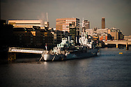 A daylight picture of HMS Belfast which is permanently moored on the banks of the River Thames in London. It forms part of the Imperial War Museum and is a Museum ship that visitors can board. She was commissioned in March 1938 and was part of the navel blockade against Germany in World War 2.