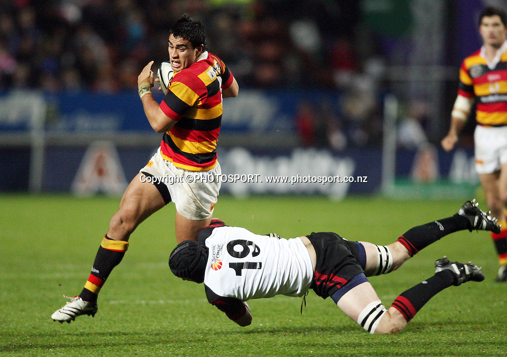 Waikato No.8 Liam Messam races away from the tackle of Hayden Hopgood during the Air New Zealand Cup week 3 rugby union match between Waikato and Canterbury at Waikato Stadium in Hamilton, New Zealand on Friday 11 August 2006. Waikato won the match 36 - 22. Photo: Kevin Booth/PHOTOSPORT<br />