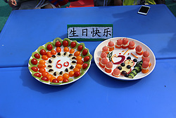 April 26, 2018 - Xiaogan, Xiaogan, China - Xiaogan, CHINA-26th April 2018: Children make fruit platters of creative patterns at a contest in Xiaogan, central China's Hubei Province, April 26th, 2018. (Credit Image: © SIPA Asia via ZUMA Wire)