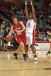 09 December 2006: Kris Coner dribbles while being blocked by Lashawn Johnson. In a non-conference game, the Redhawks of Miami (Ohio) were defeated by the Redbirds at Redbird Arena in Normal Illinois on the campus of Illinois State University.<br />