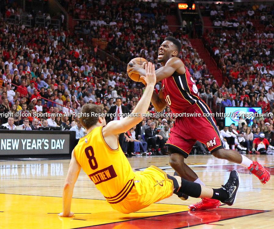 Dec. 25, 2014 - Miami, FL, USA - Miami Heat guard Norris Cole is fouled by Cleveland Cavaliers guard Matthew Dellavedova during the third quarter of an NBA basketball game on Dec. 25, 2014 at the AmericanAirlines Arena in Miami. The Heat won 101-91