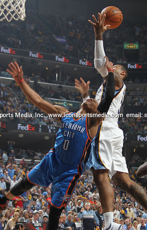 April 26, 2014 - Memphis, TN, USA - The Memphis Grizzlies' James Johnson grabs a rebound from the Oklahoma City Thunder's Russell Westbrook (0) during Game 4 of an Eastern Conference quarterfinal at FedExForum in Memphis, Tenn., on Saturday, April 26, 2014.