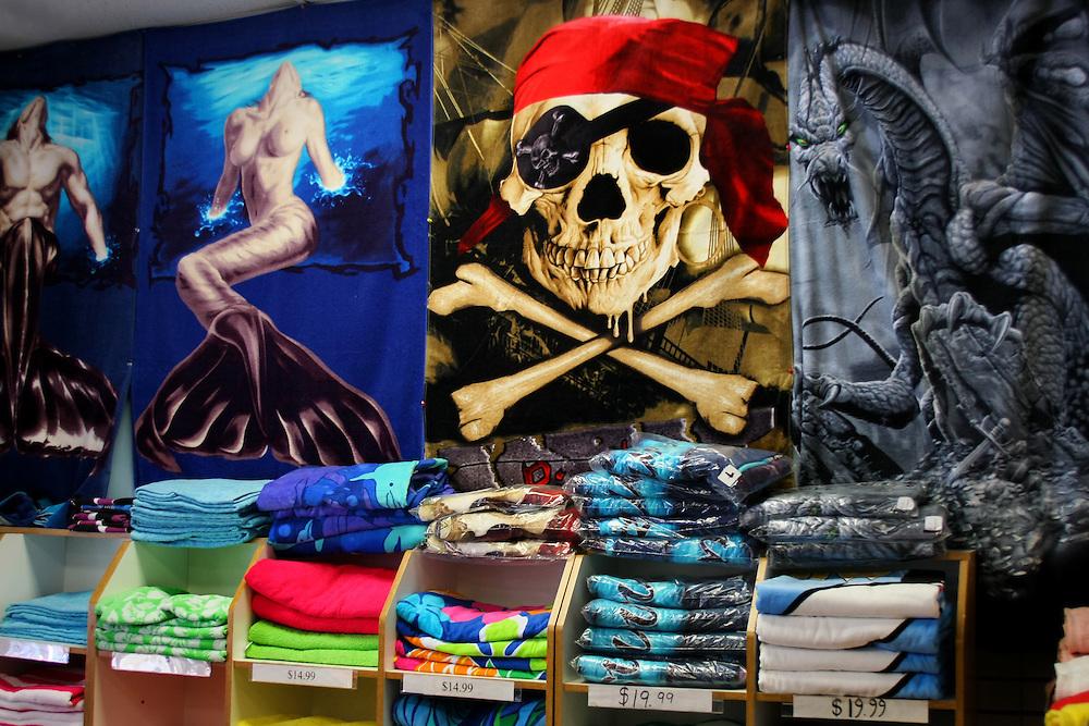 """Shirt store, near and behind """"Nathans""""."""