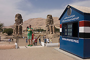 Tourism and antitquities Police hut and tourists at the ancient Egyptian Colossi of Memnon site, Luxor Nile Valley, Egypt. The Colossi of Memnon (memorial temple of Amenophis III) are two massive stone statues of Pharaoh Amenhotep III, who reigned during Dynasty XVIII. For the past 3,400 years (since 1350 BC) they have stood in the Theban necropolis, west of the River Nile from the modern city of Luxor.