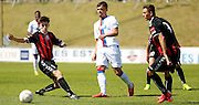 Michael Phillips playing the ball out wide during the Pre-Season Friendly match between Lewes FC and Crystal Palace at the Dripping Pan, Lewes, United Kingdom on 1 August 2015. Photo by Michael Hulf.