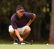 Stroke play leader Korey Mahoney of East Lansing lines up his putt on the par 4, 11th hole of the Heather course at Boyne Highlands during match play at the Michigan Amateur Golf Championship.