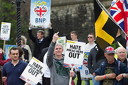 © Licensed to London News Pictures. 01/06/2013. London, UK. A British National Party (BNP) supporter reacts to Unite Against Fascism members who broke through a police during protests by both groups in central London today (01/06/2013). The BNP protest was held in response to the killing of Drummer Lee Rigby, who died after an attack in Woolwich where religious extremism may have been the motive. Photo credit: Matt Cetti-Roberts/LNP