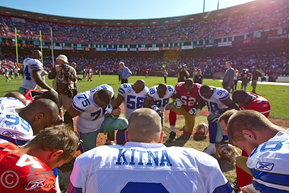 18 September 2011: Quarterback (3) John Kitna of the Dallas Cowboys prays with teammates and the San Francisco 49ers after the Cowboys 27-24 overtime victory against the 49ers in an NFL football game at Candlestick Park in San Francisco, CA.