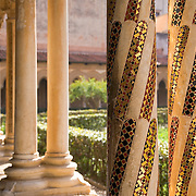 Inlaid mosaic columns in the Cloister of the Abbey of Monreale attached to the Cathedral of Monreale, Monreale, Sicily, Italy