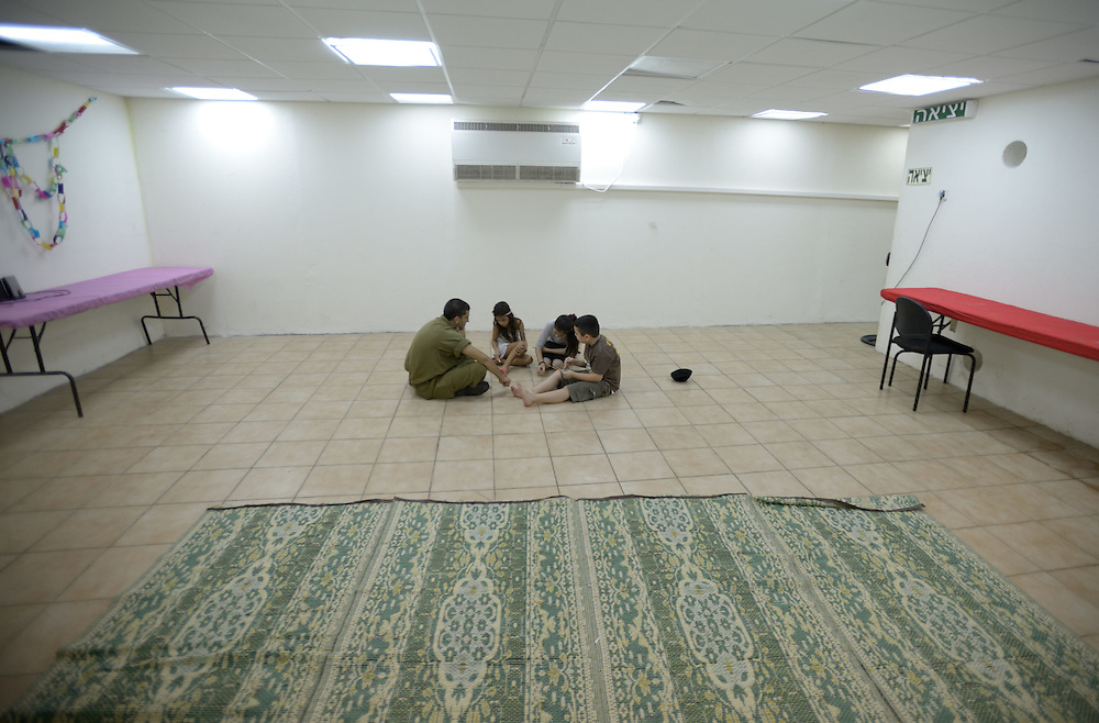 UNSPECIFIED, ISRAEL - JULY 17, 2014: Israeli children are playing in  abomb shelter in the Southern city of Sderot, on July 17, 2014. Photo by Gili Yaari.