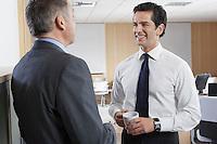 Two business men talking in office