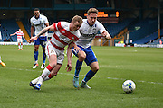 Doncaster Rovers On loan Midfielder, Gary McSheffrey and Bury Defender, Chris Hussey battle for the ball during the Sky Bet League 1 match between Bury and Doncaster Rovers at the JD Stadium, Bury, England on 9 April 2016. Photo by Mark Pollitt.