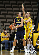 26 JANUARY 2009: Michigan center Krista Phillips (25) tries to pass the ball while being defended by Iowa center Megan Skouby (44) during the first half of an NCAA women's college basketball game Monday, Jan. 26, 2009, at Carver-Hawkeye Arena in Iowa City, Iowa. Iowa defeated Michigan 77-69.