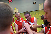 UK - Tuesday, Nov 18 2008:  Lee Atkinson (on left) and Declan McCusker (#10) lead the final shout after Barking and Dagenham Erkenwald Basketball Club's Essex Basketball League game against Brightlingsea Sledgehammers. Erks won the game 91 - 86. (Photo by Peter Horrell / http://www.peterhorrell.com)