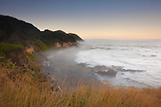 Thick fog begins to form on the beach below Strawberry Hill, located on the Oregon coast south of Yachats.