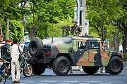 23 MAY 2014 - BANGKOK, THAILAND:  An armed Thai army Humvee at a security checkpoint in Bangkok. The Thai military seized power in a coup Thursday evening. They suspended the constitution and ended civilian rule. This is the 2nd coup in Thailand since 2006 and at least the 12th since 1932. The army has ordered both anti-government protestors in Bangkok and pro-government protestors in the suburbs to go home and arrested leaders of both groups.   PHOTO BY JACK KURTZ
