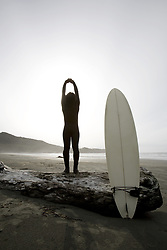 July 21, 2019 - Surfer Stretching On Beach (Credit Image: © Deddeda/Design Pics via ZUMA Wire)