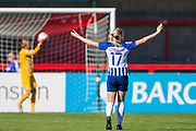 Megan Connolly (Brighton) holds up her arms as Ann-Katrin Berger (GK) (Chelsea) holds up the ball during the FA Women's Super League match between Brighton and Hove Albion Women and Chelsea at The People's Pension Stadium, Crawley, England on 15 September 2019.
