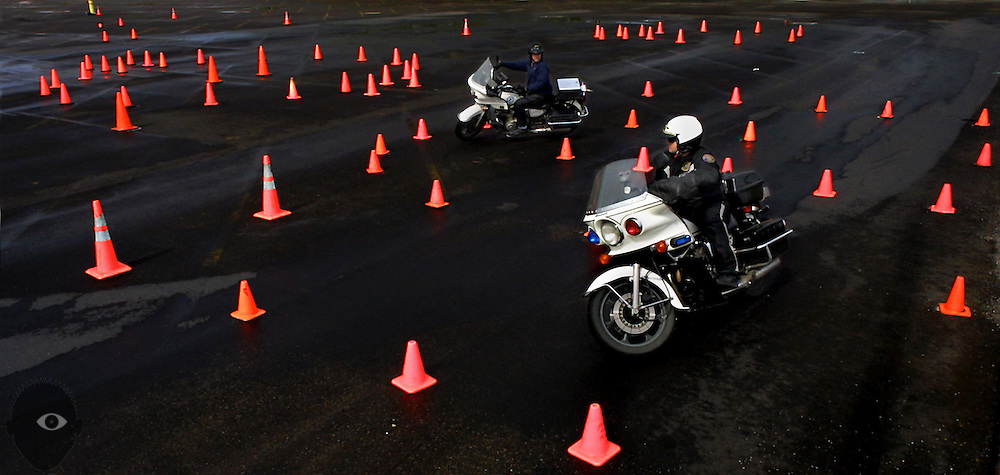 Portland Police motorcycle instructor James Sorensen (front) leads the way for trainee Portland officer Jeff Niiya. Portland and Vancouver Police motorcycle training at the Port of Portland is two weeks of continuous riding ending in the successful driving of this road course.