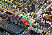 Nederland, Noord-Holland, Zaanstad, 14-06-2012; Inverdan, nieuwe stadscentrum Zaandam, masterplan Sjoerd Soeters. Station in de voorgrond. Het Zaanse huisjeshotel - Inntel Hotel - is een ontwerp Wilfried van Winden..New  center of the city of Zaandam, developed according to the master plan by architect Sjoerd Soeters. Train station in the foreground. The hotel built in a postmodern version of the style of the historic houses of Zaandam- Inntel Hotel - was designed by Wilfried van Winden...luchtfoto (toeslag), aerial photo (additional fee required).foto/photo Siebe Swart