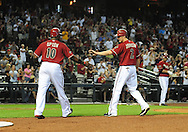 Apr. 17 2011; Phoenix, AZ, USA; Arizona Diamondbacks base runners Justin Upton (10) and Kelly Johnson (2) score during the third inning against the San Francisco Giants at Chase Field. Mandatory Credit: Jennifer Stewart-US PRESSWIRE.
