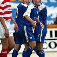 St Johnstone v Hamilton Accies 06.08.02<br />Ryan Stevenson celebrates his goal with Grant Murray<br /><br />Pic by Graeme Hart<br />Copyright Perthshire Picture Agency<br />Tel: 01738 623350 / 07990 594431