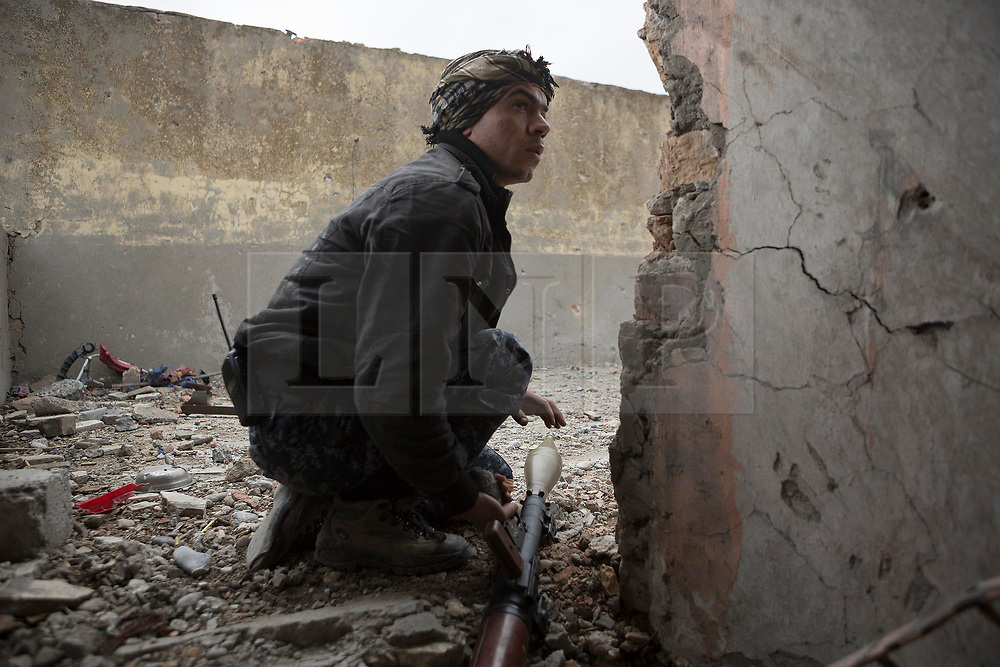 Licensed to London News Pictures. 01/04/2017. Mosul, Iraq. An Iraqi Federal Police RPG gunner looks for an ISIS target from a West Mosul rooftop in Iraq today (01/04/2017). Iraqi forces continue to fight house to house as they push further into West Mosul. Iraqi forces are now advancing on the city's old districts where Islamic State fighters still hold out. Photo credit: Matt Cetti-Roberts/LNP