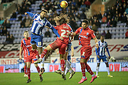 Craig Davies (Wigan) gets to the header before Bradley Dack (Gillingham) during the Sky Bet League 1 match between Wigan Athletic and Gillingham at the DW Stadium, Wigan, England on 7 January 2016. Photo by Mark P Doherty.