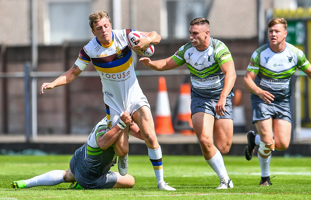 Whitehavens' Jordan Burns is tackled by West Wales Raiders' Shaun Tennant<br /> <br /> Photographer Craig Thomas/Replay Images<br /> <br /> Betfred League 1 - West Wales Raiders v Whitehaven  - Saturday 23rd June 2018 - Stebonheath Park - Llanelli<br /> <br /> World Copyright © 2017 Replay Images. All rights reserved. info@replayimages.co.uk - www.replayimages.co.uk