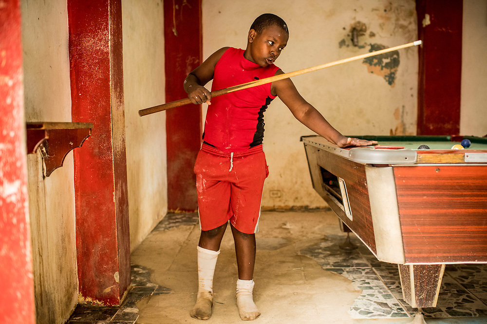 July 22, 2017, El Mamon, Dominican Republic:<br /> A local boy plays billiards in El Mam&oacute;n during the 2017 Lindos Sue&ntilde;os trip in the Dominican Republic Saturday, July 22, 2017. <br /> (Photo by Billie Weiss/Boston Red Sox)