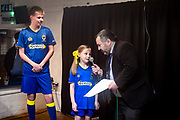 Ivor Heller gives the man of the match presentation and speaks with the match day mascots after the EFL Sky Bet League 1 match between AFC Wimbledon and Fleetwood Town at the Cherry Red Records Stadium, Kingston, England on 30 March 2018. Picture by Stephen Wright.