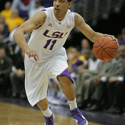Jan 09, 2010; Baton Rouge, LA, USA; LSU Tigers guard Bo Spencer (11) drives with the ball against the Alabama Crimson Tide during the first half at the Pete Maravich Assembly Center. Alabama defeated LSU 66-49.  Mandatory Credit: Derick E. Hingle-US PRESSWIRE