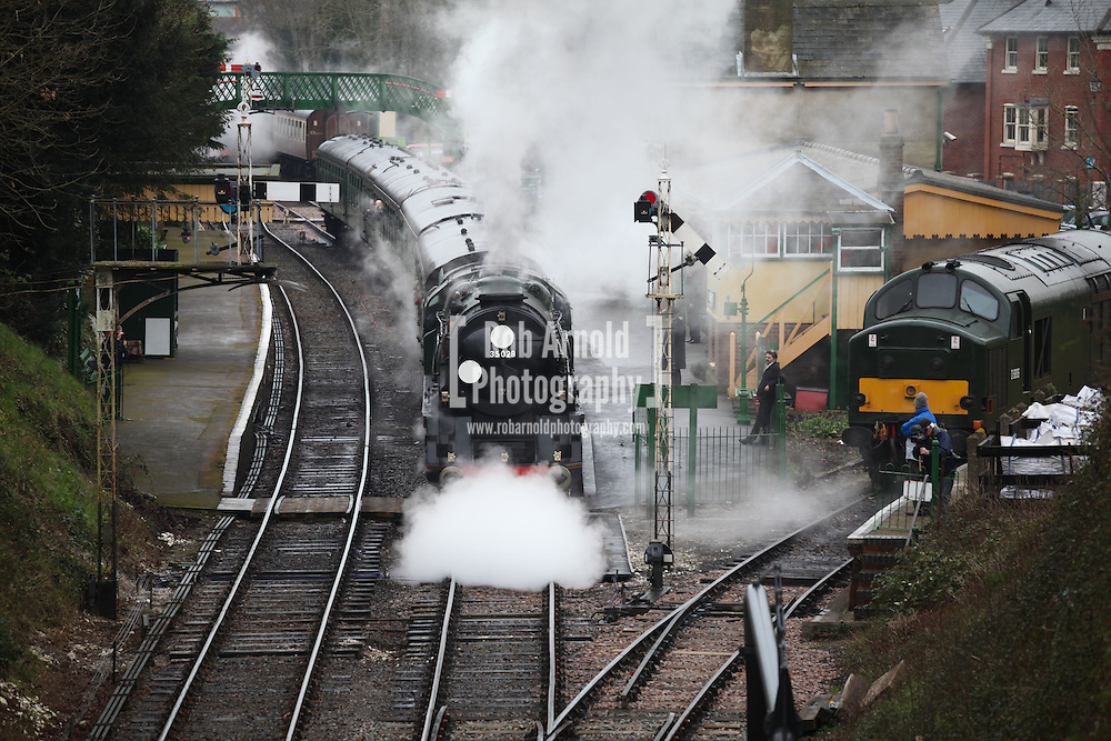 © Rob Arnold. 07/03/2014. Hampshire, UK. The steam locomotive '35028 - Clan Line', pulls out of Alresford Station today, 7th March 2014, which is the first day of the 'spring steam gala' on the Watercress Line. The railway line, operated by Mid Hants Railway Ltd, passes between Alresford and Alton in Hampshire. The line is named after its use in the past for transporting freshly cut watercress from the beds surrounding Alresford to London. Photo credit : Rob Arnold