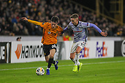 Oskar Burr of Wolverhampton Wanderers & Tyler Boyd of Besiktas during the Europa League match between Wolverhampton Wanderers and Besiktas at Molineux, Wolverhampton, England on 12 December 2019.