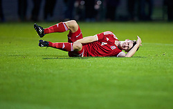 NEWPORT, WALES - Thursday, September 25, 2014: Wales' Liam Angel injured against France during the Under-16's International Friendly match at Dragon Park. (Pic by David Rawcliffe/Propaganda)