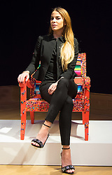 "Bonhams, London, February 29th 2016. Made In Chelsea's Victoria Baker-Harber with her chair which features hundreds of Guatemalan ""worry dolls"" during a photocall for ""Sitting Pretty"", featuring unique, hand painted and upholstered chairs made by 30 celebrities and artists, at Bonhams ahead of their auction in support of a leading AIDS charity, CHIVA Africa.<br /> ©Paul Davey<br /> FOR LICENCING CONTACT: Paul Davey +44 (0) 7966 016 296 paul@pauldaveycreative.co.uk"