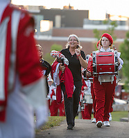 Debbie Gibson leads the Laconia Sachems Marching Band up to Jim Fitzgerald Field for their home opener on Friday night.  (Karen Bobotas/for the Laconia Daily Sun)