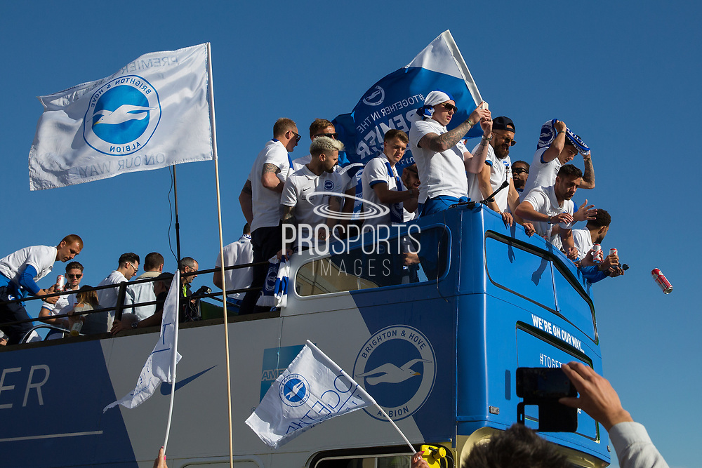 Player drops can of lager from the open top bus during the Brighton & Hove Albion Football Club Promotion Parade at Brighton Seafront, Brighton, East Sussex. United Kingdom on 14 May 2017. Photo by Ellie Hoad.