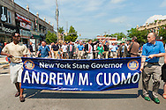 MAY 30, 2011 - Little Neck, New York, U.S. - New York Governor ANDREW CUOMO (Democrat) marches in Little Neck-Douglaston Memorial Day Parade which honors America's veterans, on Northern Boulevard. A big blue banner with 'New York State Governor Andrew M. Cuomo' written on it is at front of Governor and group marching with him.