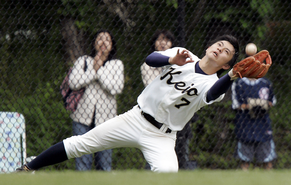Keio third baseman Gota Kato makes a diving catch during the boys varsity baseball Class C regional final game between Keio Academy and Oyster Bay at Rye Neck High School June 10, 2009. Oyster Bay won the game 3-1. ( Mike Roy / The Journal News )