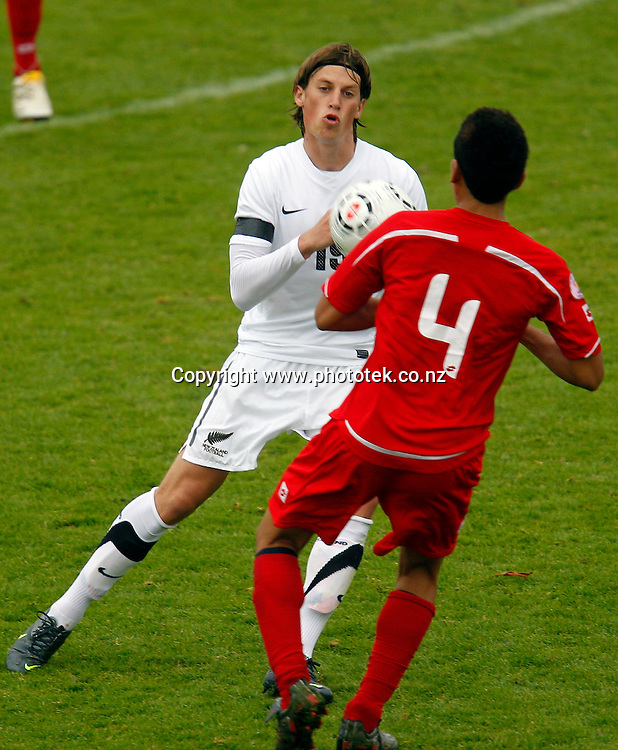 NZ's Daniel Saric comes up against Tonga's Christian Likio. OFC Men's Olympic Qualifier New Zealand 2012, Tonga v New Zealand, Owen Delany Park Taupo, Wednesday 21st March. Photo: Shane Wenzlick
