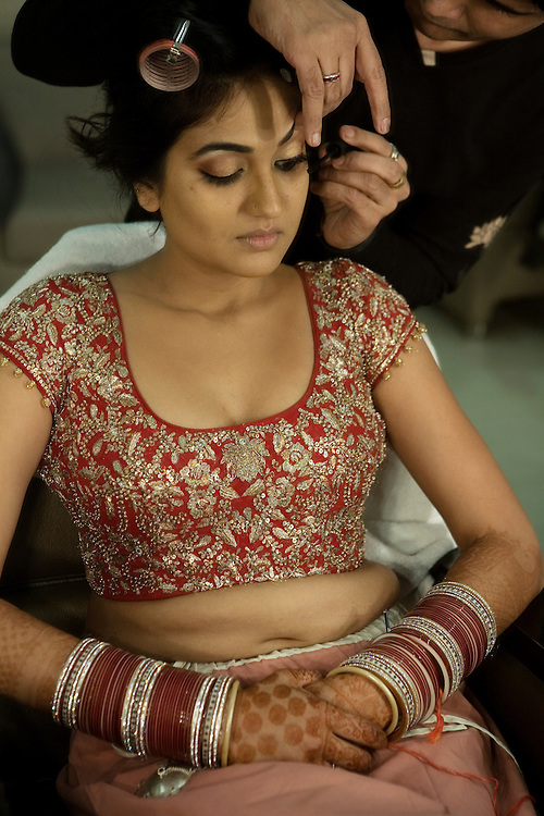 New Delhi, India, January 21, 2011. Sumedha, the Bride, is getting ready for the ceremony the day of her wedding in a beauty salon in Delhi.