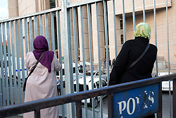 "Two women wait in front of Istanbul's courthouse. A Turkish court was due on July 28 to decide whether to release journalists from the opposition newspaper Cumhuriyet jailed on charges of supporting ""terrorism"", in a trial seen as a test for press freedom under President Recep Tayyip Erdogan. The court decided for continuation of arrest of 5 of the total of 19 defendants: chief editor Murat Sabuncu; journalists Kadri Gürsel and Ahmet Şık; executive board member Akın Atalay, and, Kemal Aydoğdu, an individual not affiliated with Cumhuriyet but tried in the case over accusation of being the holder of the Twitter account named as Jeansbiri.<br /> Member of the executive board of Cumhuriyet Foundation Önder Çelik, columnist Hakan Kara, ombudsman Güray Öz, lawyer Mustafa Kemal Güngör, chief editor of supplement on books Turhan Günay, lawyer and executive board member Bülent Utku, and cartoonist Musa Kart have been ordered to be released. Except for Turhan Günay, all released journalists and professionals will be free with a condition of legal control.<br /> The court decided for continuation of arrest of 5 of the total of 19 defendants: chief editor Murat Sabuncu; journalists Kadri Gürsel and Ahmet Şık; executive board member Akın Atalay, and, Kemal Aydoğdu, an individual not affiliated with Cumhuriyet but tried in the case over accusation of being the holder of the Twitter account named as Jeansbiri.<br /> Member of the executive board of Cumhuriyet Foundation Önder Çelik, columnist Hakan Kara, ombudsman Güray Öz, lawyer Mustafa Kemal Güngör, chief editor of supplement on books Turhan Günay, lawyer and executive board member Bülent Utku, and cartoonist Musa Kart have been ordered to be released. Except for Turhan Günay, all released journalists and professionals will be free with a condition of legal control. Istanbul, Turkey, on July 28, 2017. Photo by Gulsin Ketenci/NARphotos/ABACAPRESS.COM"