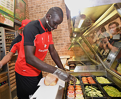 KUALA LUMPUR, MALYASIA - Thursday, July 23, 2015: Liverpool's Mamadou Sakho  makes Subway sandwich for supporters during an event at the Paradigm Mall on day eleven of the club's preseason tour. (Pic by David Rawcliffe/Propaganda)
